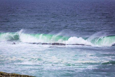 Photo for Ocean waves breaking on stone coast in Mullaghmore peninsula in County Sligo, Ireland - Royalty Free Image
