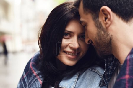 Photo for Girl in denim jacket covered in plaid. Loves looking at guy. Romantic concept. - Royalty Free Image