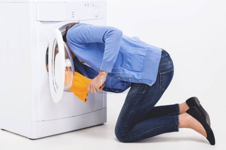 Woman shoved her head into washing machine. Search...