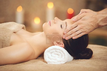 Smiling Woman Getting Massage in Health Spa
