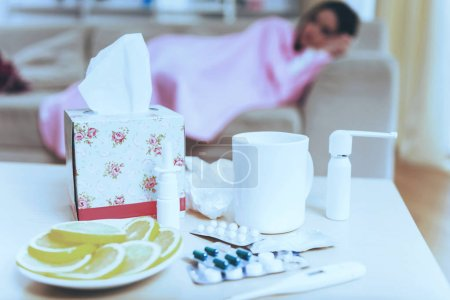 Photo for Pills Tea Lemon and Napkins. Sadness Woman. Top View. Medications in Closeup. Cup of Tea. Young Brunette Disease. Virus and Sad. Treatment at Home. Sikness Symptom. Infection and Healthcare. - Royalty Free Image