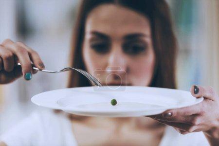 White Plate with Pea Closeup.