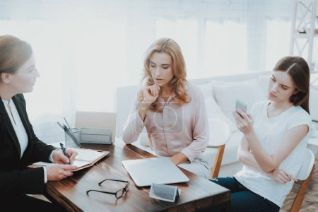 Mother and Young Daughter in Psychologist Office. Visit to Doctor. Conflict in Family. Parent and Child. Unhappy Woman. Communication Concept. Relationship Concept. Psychotherapy Concept.