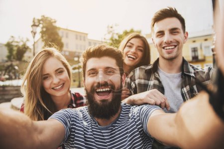 Photo for Young Happy People Have Fun Outdoors in Autumn. Fiendship Concept. Smiling People. Happy Friends. Communication with Friends Concept. Weekend in Autumn. Young People in University. - Royalty Free Image