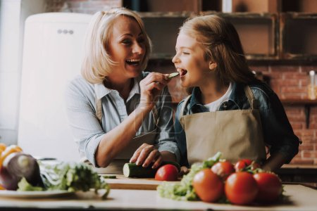 Photo for Cute Grandma and Granddaughter Cutting Vegetables. Grandma and Granddaughter Cooking Food. Vegetable Salad. Diet. Dieting Concept. Healthy Lifestyle. Cooking At Home. Prepare Food - Royalty Free Image
