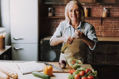 Photo for Senior Woman Cooking Salad in Kitchen at Home. Grandma Cooking Food. Healthy Food Concept. Vegetable Salad. Diet. Dieting Concept. Healthy Lifestyle. Cooking At Home. Prepare Food - Royalty Free Image
