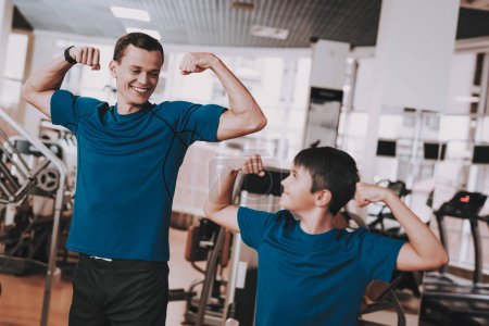 Young Father and Son Preparing for Training in Gym. Healthy Lifestyle Concept. Sport and Training Concepts. Modern Sport Club. Sport Equipment. Family Sport. Running Tracks. Parent with Child.