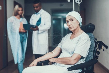 Woman with mother. Cancer Patient. Doctor keep Medical History. Upset Women. Doctor in Ward. Woman Undergoes Rehabilitation. After Treatment for Cancer. Woman on Bunk. Doctor in Clinic. Doomed Look.