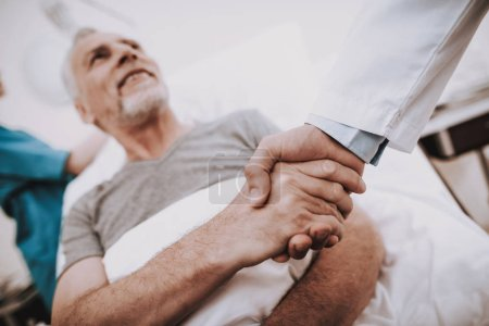 Handshake with Doctor. Patient in Clinic. Patient in Hospital. Patiend and Doctor in White Room. Medicine Help Patient. Diagnosis for Old Man. Clinic and People. Hospital and Man. Docto with Sick Man