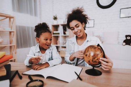 Mother Help Little Girl with Globe and Lessons. Little Girl and Mother Play with Globe. Relaxation with Mother. Smile and Happy Day with Mother and Lessons. Study Lessons all Family. Tesy for Girl.