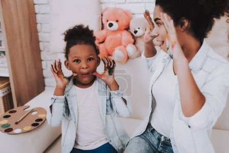 Smile and Happy Time with Mother and Daughter. Hobbies for Mother and Daughter. Offspring with Mother. Painter and Happy Mother. Bear with Little Girld And Beautiful Mother. Relaxation for Mother.