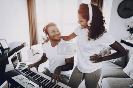 Afro American Couple Listening With Headphones Synthesizer Playing. Happy Songwriter. Morning Leisure. Digital Format Sound Record. Working Musician. Musical Hobby. Hands On Keyboard.