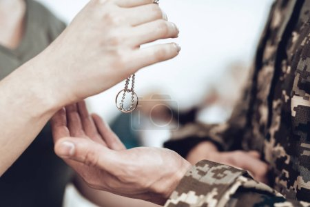 A Man Goes To Military Service. Saying Goodbye. Leaving To Army. Farewell With Family. Camouflage Uniform. Wife Hanging. Feelings Showing. Guard Of Peace. Patriotic Decision. Lucky Talisman.