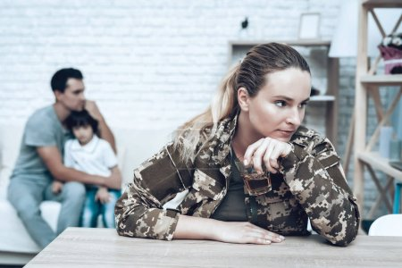 Woman In Camouflage Drinks. Depression After War Concept. Military Memories Trauma. Sad Homecoming. Husband With Son Background. Returning From Army. Posttraumatic Syndrome. Family Sorrow.