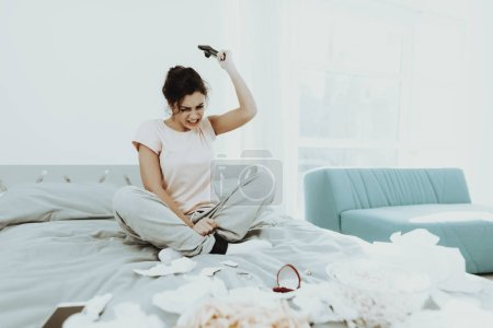 Mournful Girl With Flowed Mascara Plays Console On The Bed. Unhappy Holiday. Sad Weekend. Tears On The Face. Sunny Day. Alone In The Bedroom. Disappointed Woman. Spoiled Makeup. Bad Mood.