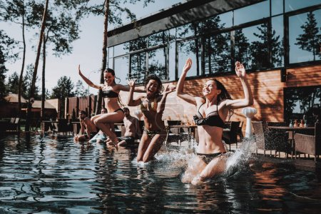 Photo for Young Smiling Friends Jumping into Swimming Pool. Group of Young Happy People having Fun by Jumping from Poolside into Water. Friends Enjoying Outdoor Pool Party. Summer Vacation Concept - Royalty Free Image