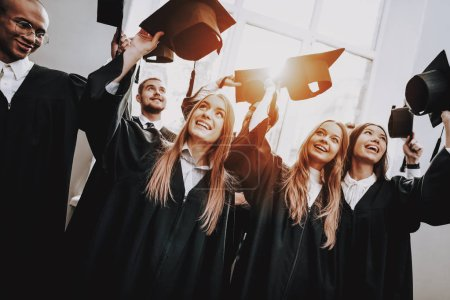 Photo for Study Together. Graduate. Best Friends. Finish Studies. Group of Young People. Architecture. University. Students. Good Mood. Have Fun. Friendship. Cap. Campus. Happiness. Knowledge. - Royalty Free Image
