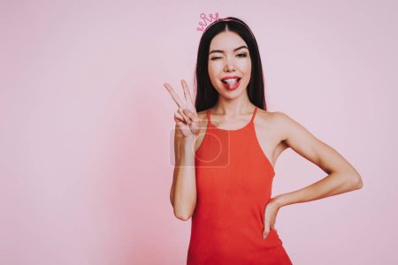 Girl in Red Dress. Pink Background. Celebrating Women's Day. Girl with Bear. Smiling Girl. Happy Woman. Happy Emotions. International Party. Beautiful Woman with Crown. Woman on Pink Background.