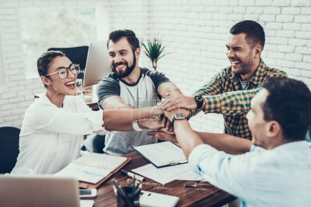 Photo for Young Workers on Teambuilding in Modern Office. Communication with Colleagues. Teambuilding at Work. Smiling Woman. Smiling Manager. Teamwork in Office. Happy People. Business Concept. - Royalty Free Image