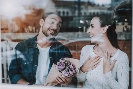 Photo for Happy Together. Love. Flowers. Have Fun. Tea Party. Smiling People. Enjoyment. Guy and Girl. Bonding. Together in Cafe. Cheerful Girl. Leisure Time. Good Relationship. Happy Holidays. Drink Tea. - Royalty Free Image