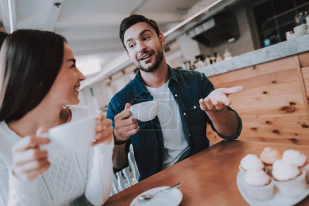 Love. Together in Cafe. Leisure Time. Teapot. Cheerful Girl. Drink Tea. Have Fun. Tea Party. Smiling People. Enjoyment. Guy and Girl. Bonding. Good Relationship. Happy Holidays. Happy Together.