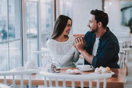 Together in Cafe.Tea. Cupcake. Cheerful Girl. Happy Together. Smiling People. Love Story. Tea Party.Have Fun. Enjoyment. Guy and Girl. Leisure Time. Good Relationship. Happy Holidays. Teapot.Bonding.