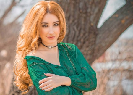 Photo for Redhead romantic girl in green blouse, boho style, concept of hair, wig - Royalty Free Image