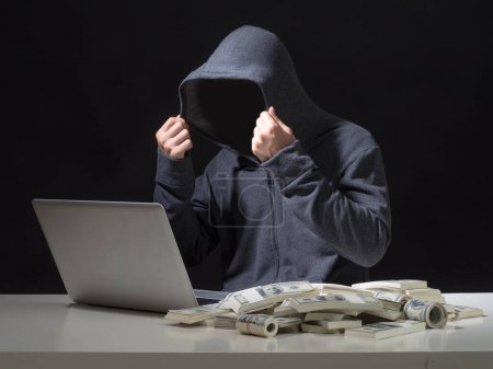 Cyber attack with unrecognizable hooded hacker.Hac...