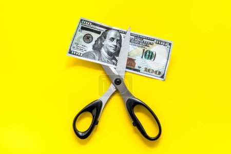 Photo for Decline of dollar exchange rate. Scissors cut dollars banknote. - Royalty Free Image