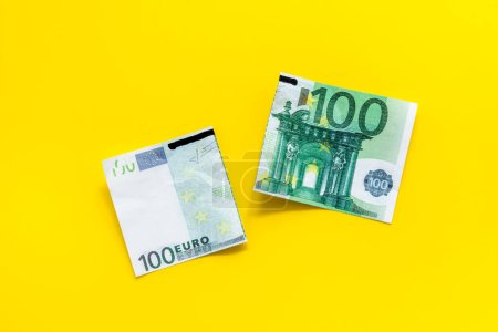 Photo for Cutting of euro banknote. Economic crisis concept. - Royalty Free Image