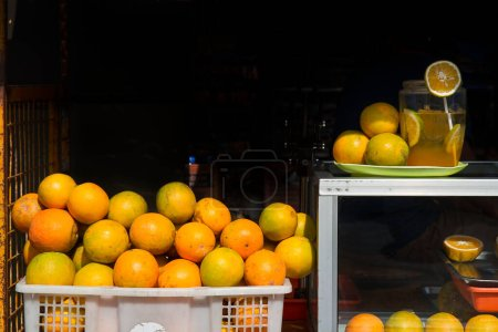 Photo for Orange fruits on juice street stall - Royalty Free Image