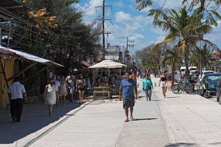 TULUM, MEXICO-MARCH 04, 2018: restaurants and tourists on avenida tulum, tulum, quintana roo, mexico