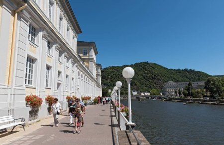 BAD EMS, GERMANY-JULY 08, 2018: walker on the shore prommenad on the lahn river, Bad Ems, Germany.