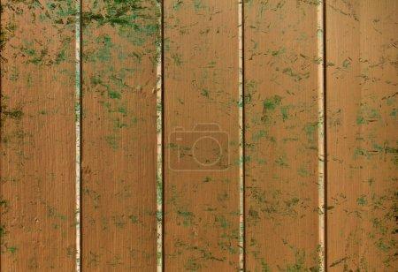 Foto de Un primer plano de paneles de madera vieja manchados con salpicaduras de pintura - Imagen libre de derechos