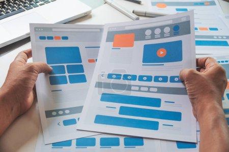 Photo pour Website designer Creative planning application developer development draft sketch template layout prototype framework wireframe design studio. Concept d'expérience utilisateur . - image libre de droit
