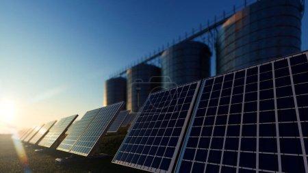 Foto de Paneles solares en un campo verde con silos - Imagen libre de derechos