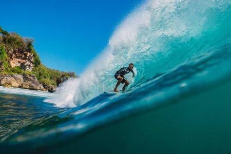 July 7, 2018. Bali, Indonesia. Surfer ride on big barrel wave at Padang Padang, Bali. Professional surfing in ocean