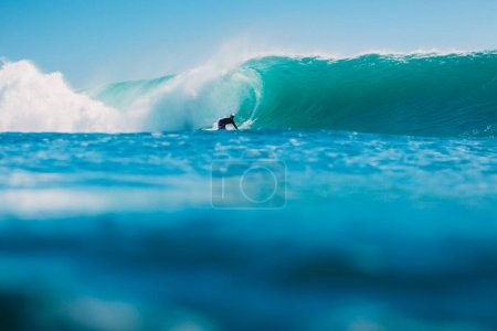 July 7, 2018. Bali, Indonesia. Surfer ride on big barrel wave at Padang Padang, Bali. Professional surfing in ocean