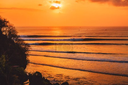 Photo for Colorful sunset or sunrise with ocean and big waves fo surfing - Royalty Free Image