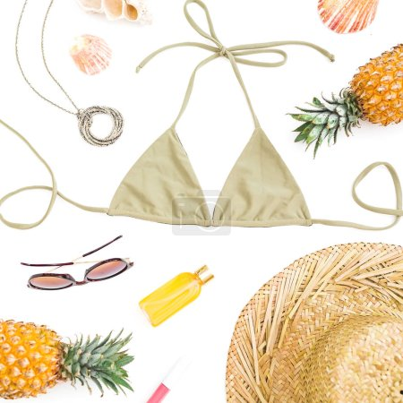 Photo for Beach tropical concept. Pineapple fruits, sun glasses, straw hat and bikini swimwear on white background. Flat lay, top view. - Royalty Free Image