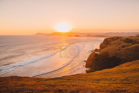 picturesque view of tranquil tropical seashore at sunset