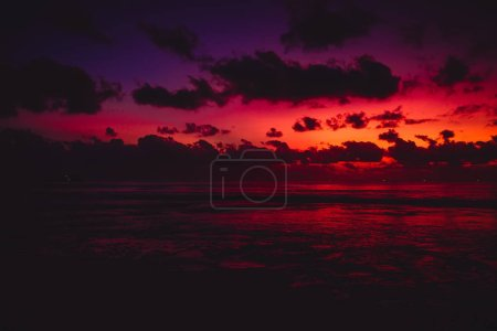 Colorful bright sunset or sunrise at  beach with ocean