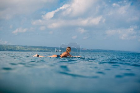 Photo for Surfer girl on the surfboard. Woman with surfboard in ocean - Royalty Free Image