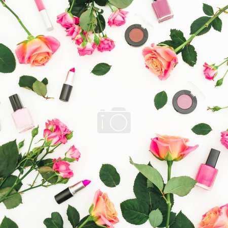 Beauty frame composition with roses flowers and feminine make up cosmetics on white background. Flat lay, top view.
