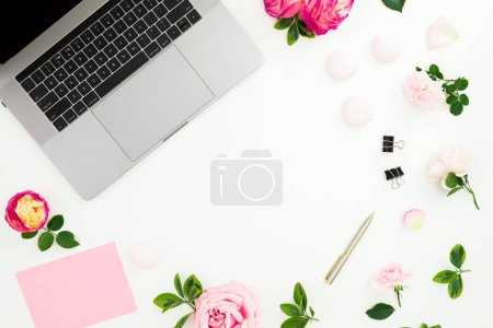 Photo for Laptop with pink flowers, pen, envelope and petals on white background. Flat lay. Top view. - Royalty Free Image