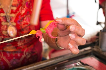 Photo for Partial view woman hands holding asian decoration - Royalty Free Image