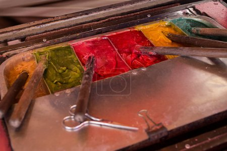 Photo for Colorful paint, palette with wooden sticks - Royalty Free Image