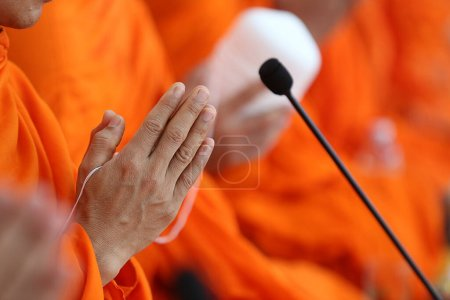 Photo for Buddhist monks parrying with hands at microphone - Royalty Free Image