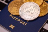 foreign passports and bitcoin coin ukraine and cryptocurrency concept