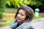 beautiful arabic girl winks to camera in Germany on the street
